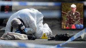 "A police forensic officer works at the scene where a coat, shoe and handbag lie on the pavement outside the library in Birstall where Labour MP Jo Cox was shot on June 16, 2016.Campaigning for Britain's EU referendum next week was suspended on July 16 following news a leading MP with the ""Remain"" camp was in a critical condition after being shot. Jo Cox, a 41-year-old mother-of-two from the opposition Labour Party, was left bleeding on the pavement after the incident in the town of Birstall in northern England, according to witnesses quoted by local media. / AFP / OLI SCARFF (Photo credit should read OLI SCARFF/AFP/Getty Images)"
