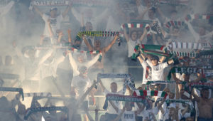 WARSAW, POLAND - AUGUST 23: Supporters of Legia Warsaw sing during Legia Warsaw v Dundalk FC - UEFA Champions League Play Off 2nd Leg at the Wojsko Polskie Stadium on August 23, 2016 in Warsaw, Poland. (Photo by Adam Nurkiewicz/Getty Images)