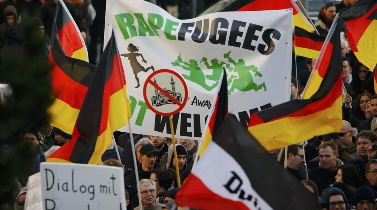 Supporters of anti-immigration right-wing movement PEGIDA  Patriotic Europeans Against the Islamisation of the West  take part in in demonstration march  in reaction to mass assaults on women on New Year s Eve  in Cologne  Germany  January 9  2016    REUTERS Wolfgang Rattay